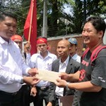Protesters deliver letter to President Thein Sein to an Embassy official