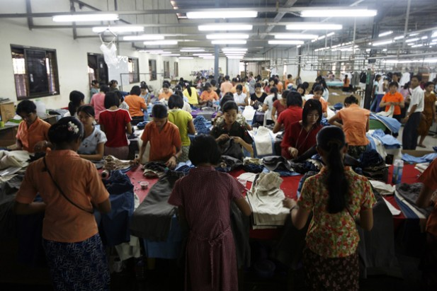 workers-arrange-talored-clothing-Irrawaddy