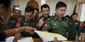 Military representative members of Myanmar's Parliament register as they attend a Parliament meeting at Lower House of Parliament in Naypyitaw